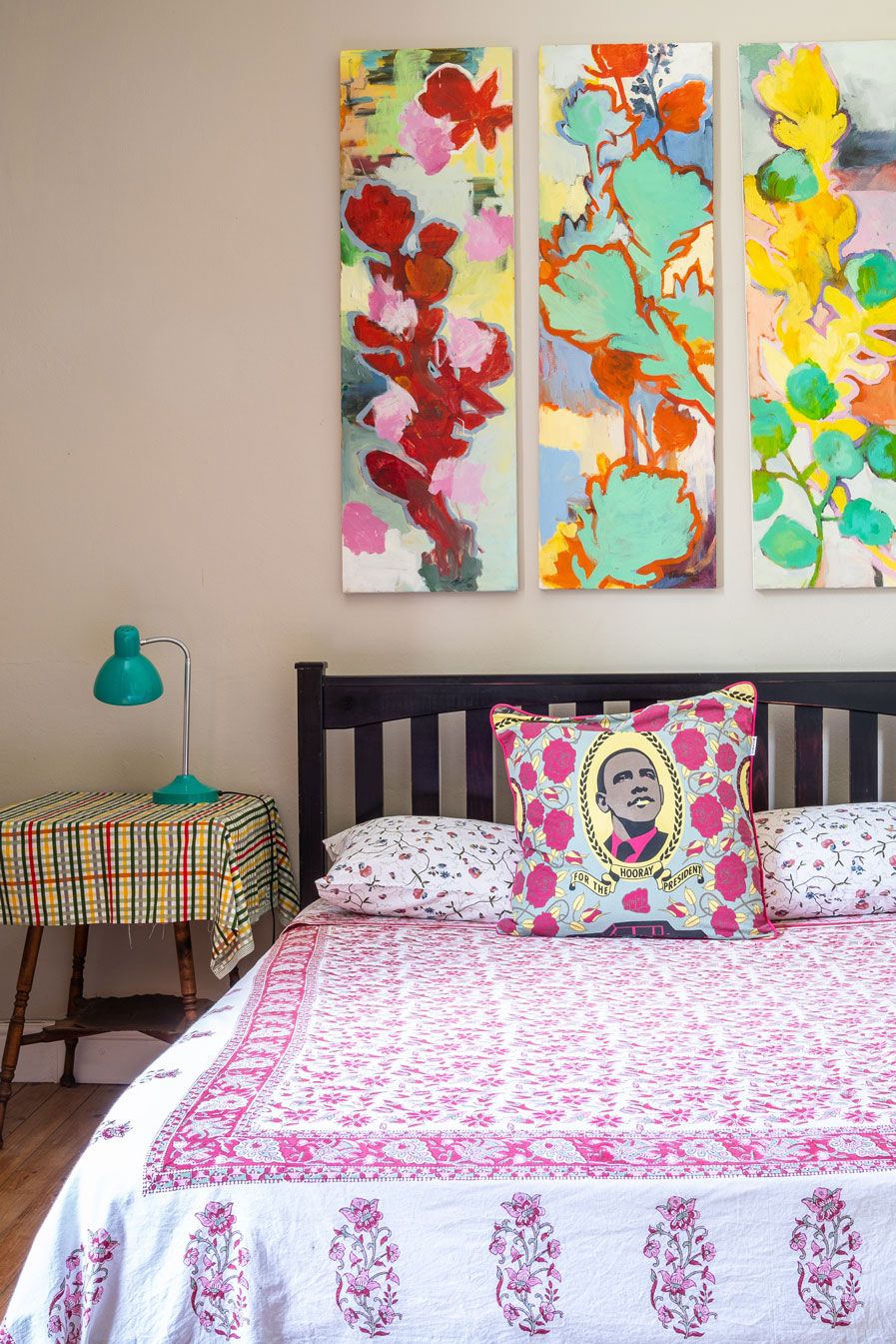 Colourful bedroom with a mix of bold patterns and graphic, illustrative fabrics
